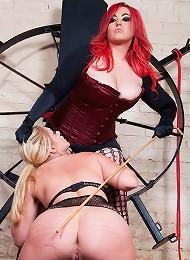 Mistress Jemstone gets Shay Hendrix on a wheel for punishing