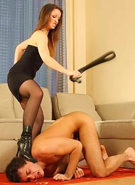 Naughty slave licking moist shaven pussy of his beautiful mistress